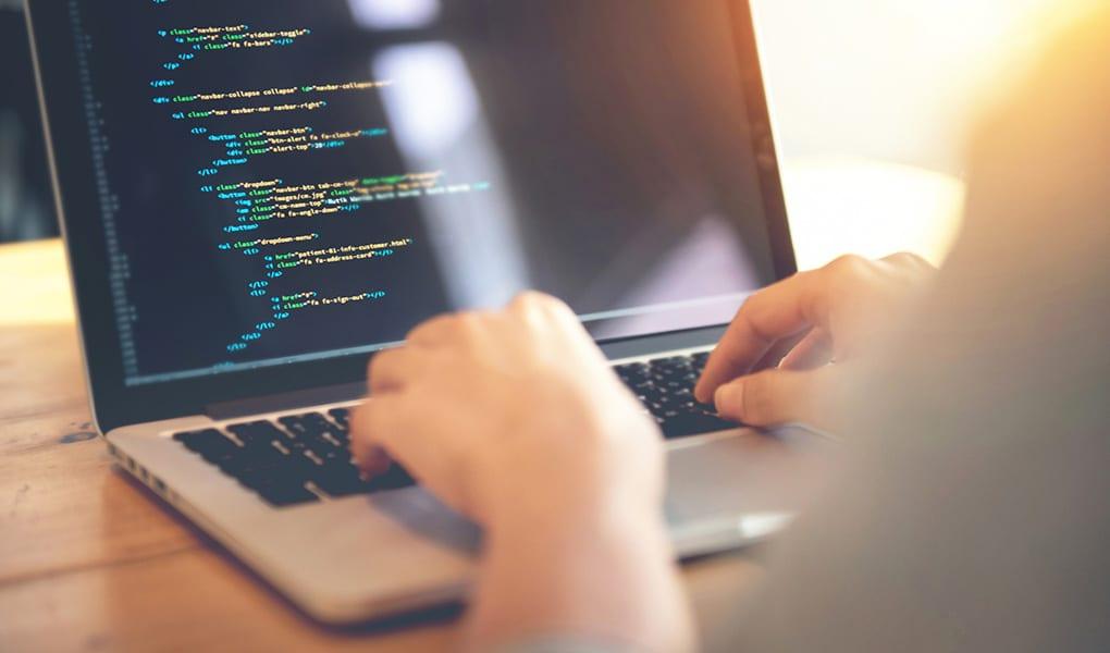 developer writing website design code
