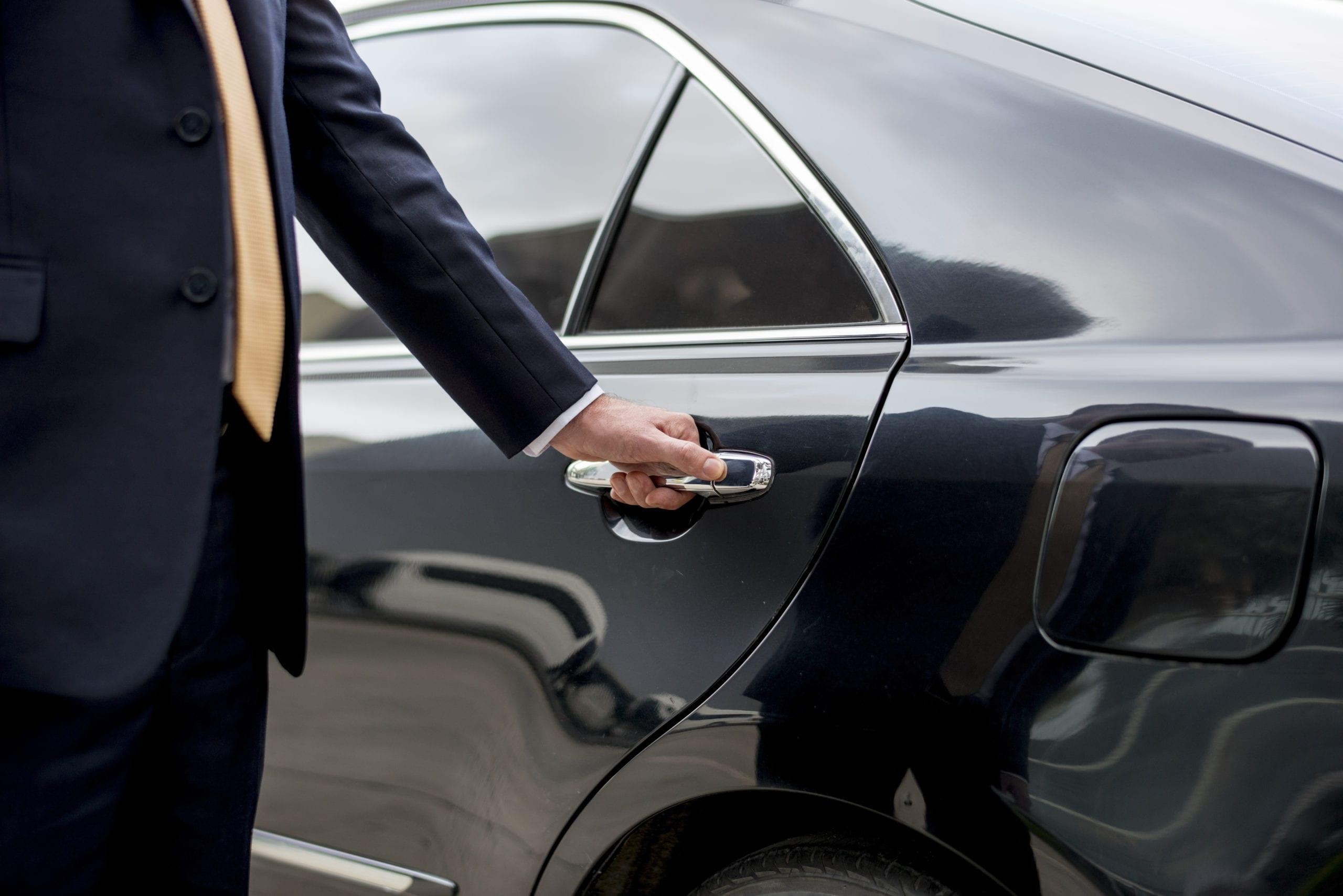 limo service driver opens door
