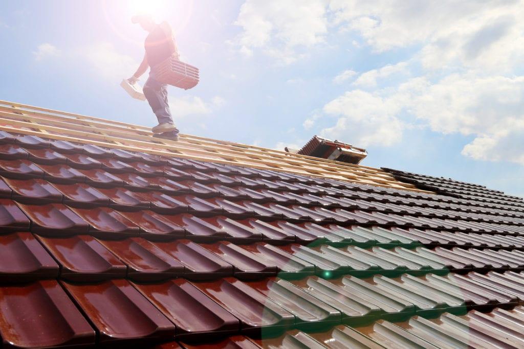 roofer installing tile roof