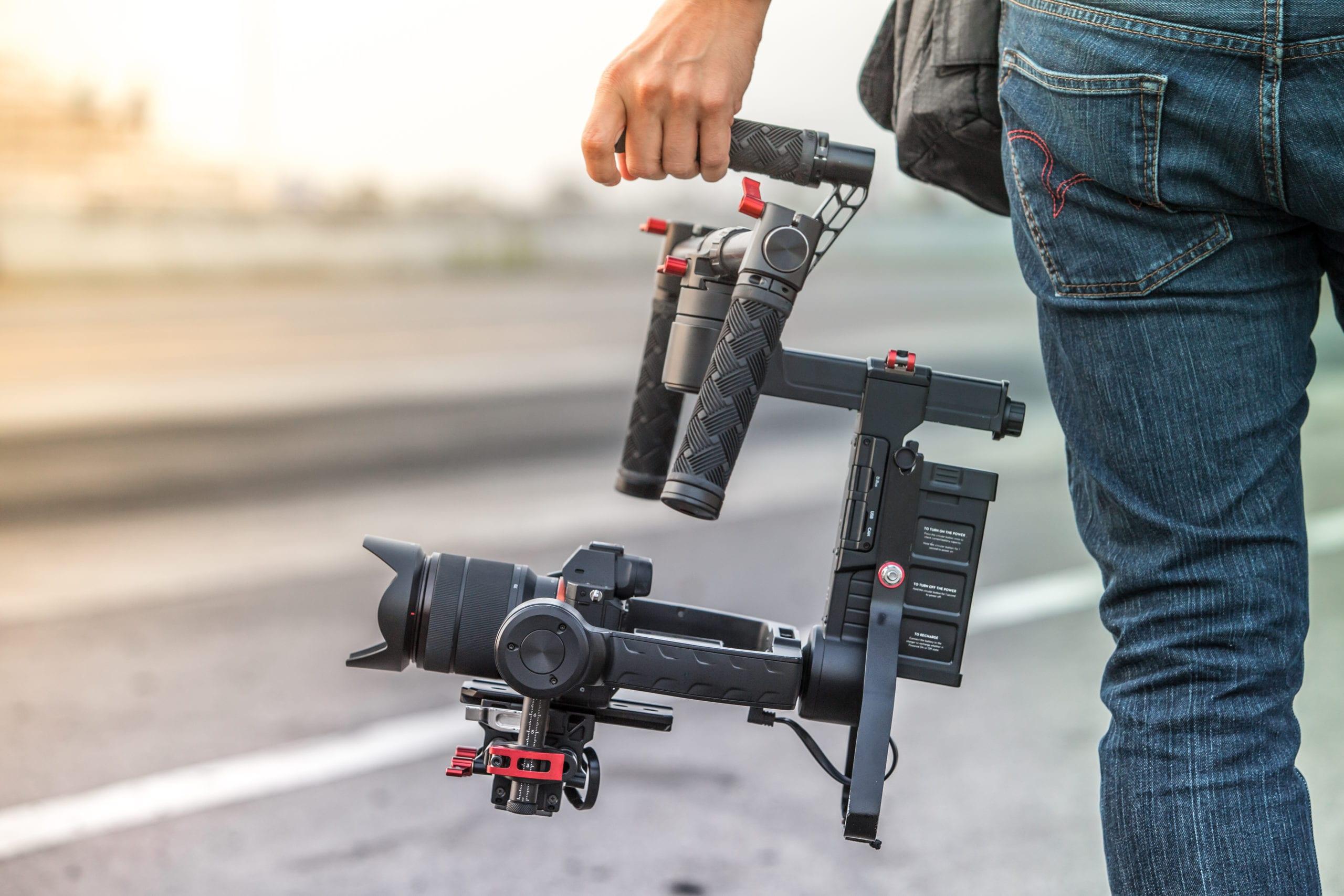 Man holding video equipment